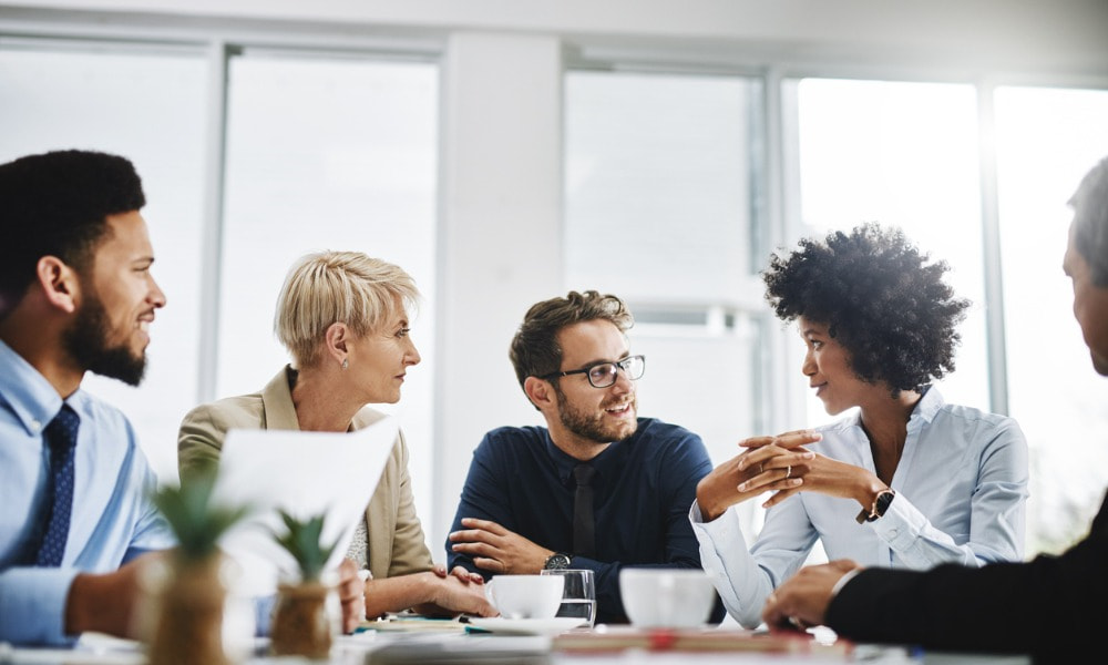 Employees learn from each other during an employee development event.